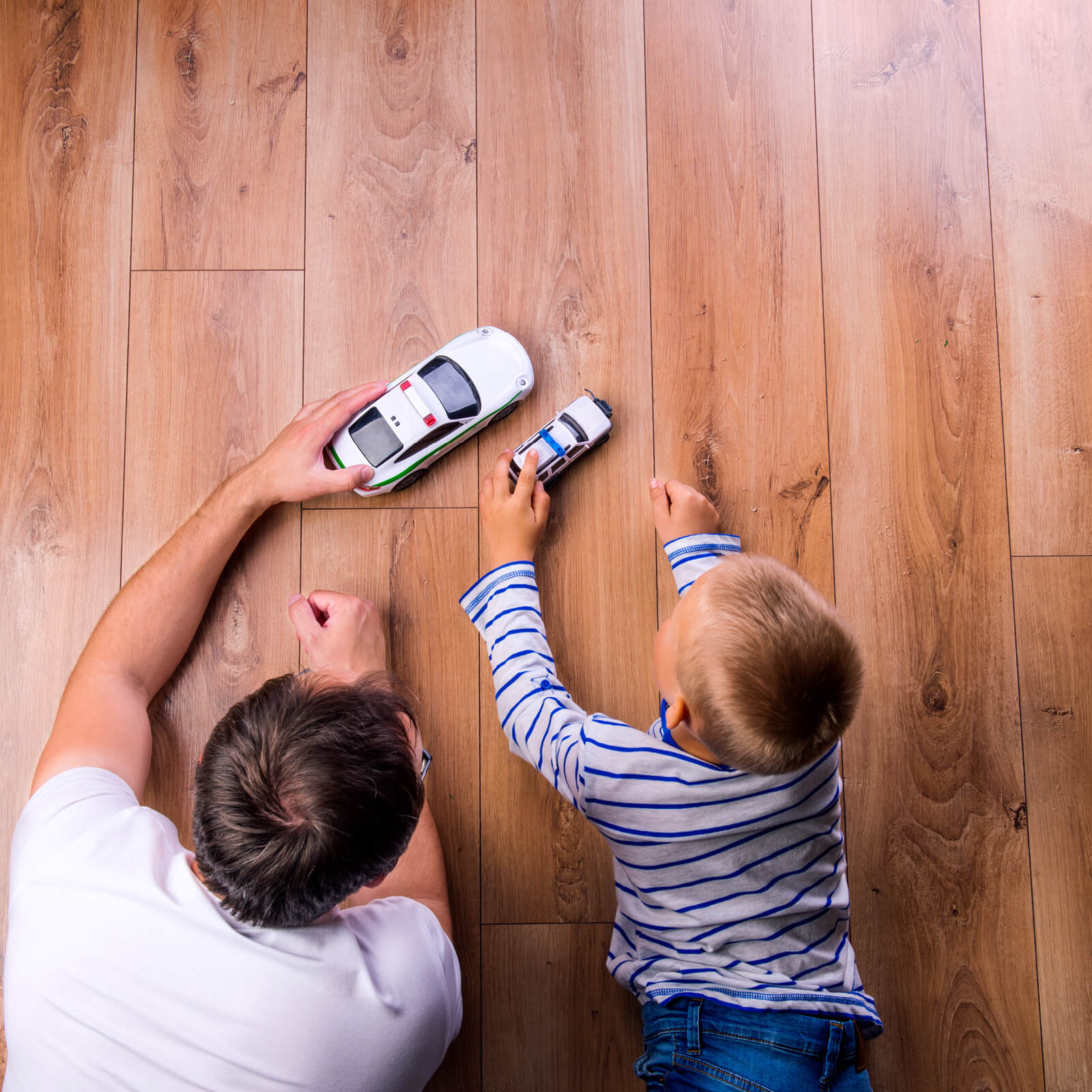 Father and kid playing with toycar | Shans Carpets And Fine Flooring Inc